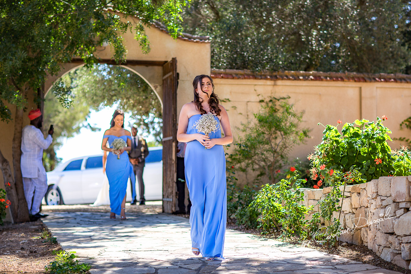 Moments with the bridesmaid captured at a wedding at Minthis Hills in Cyprus, by Cristian Dascalu.
