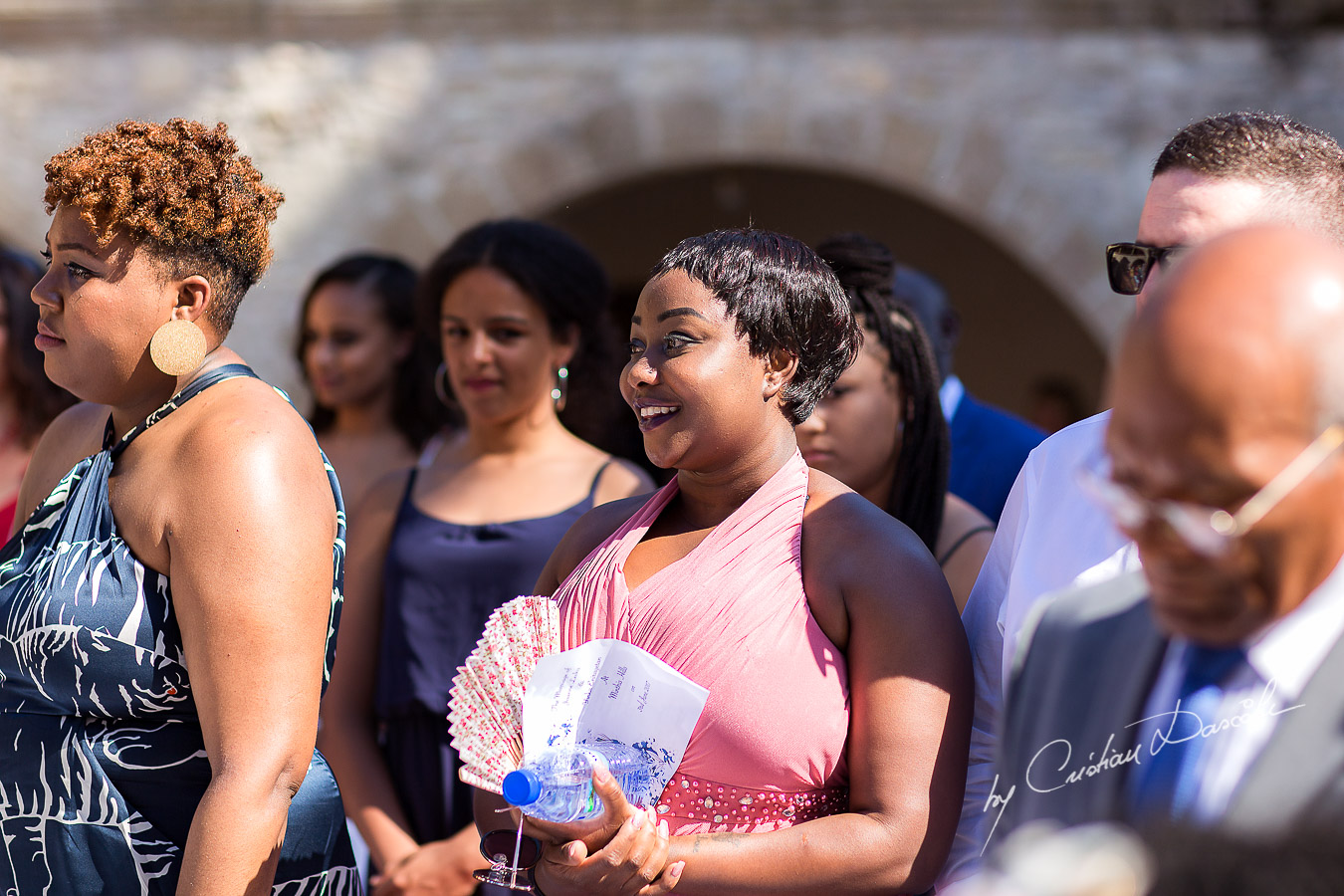 Moments with the guests smiling captured at a wedding at Minthis Hills in Cyprus, by Cristian Dascalu.