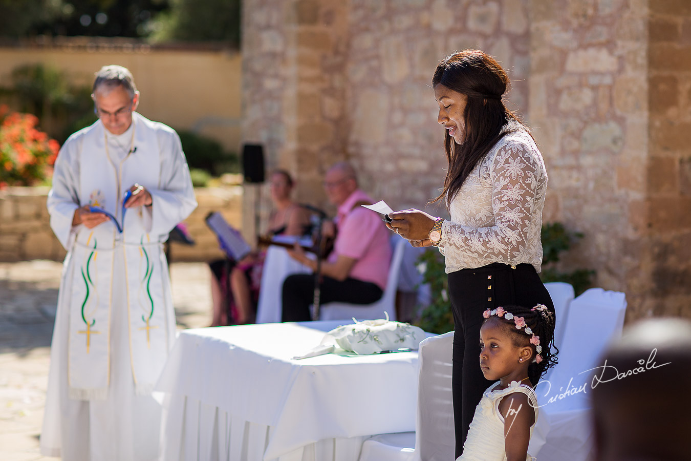 Moments when a guest is reading a poem, captured at Beautiful ceremony moments captured at a wedding at Minthis Hills in Cyprus, by Cristian Dascalu.