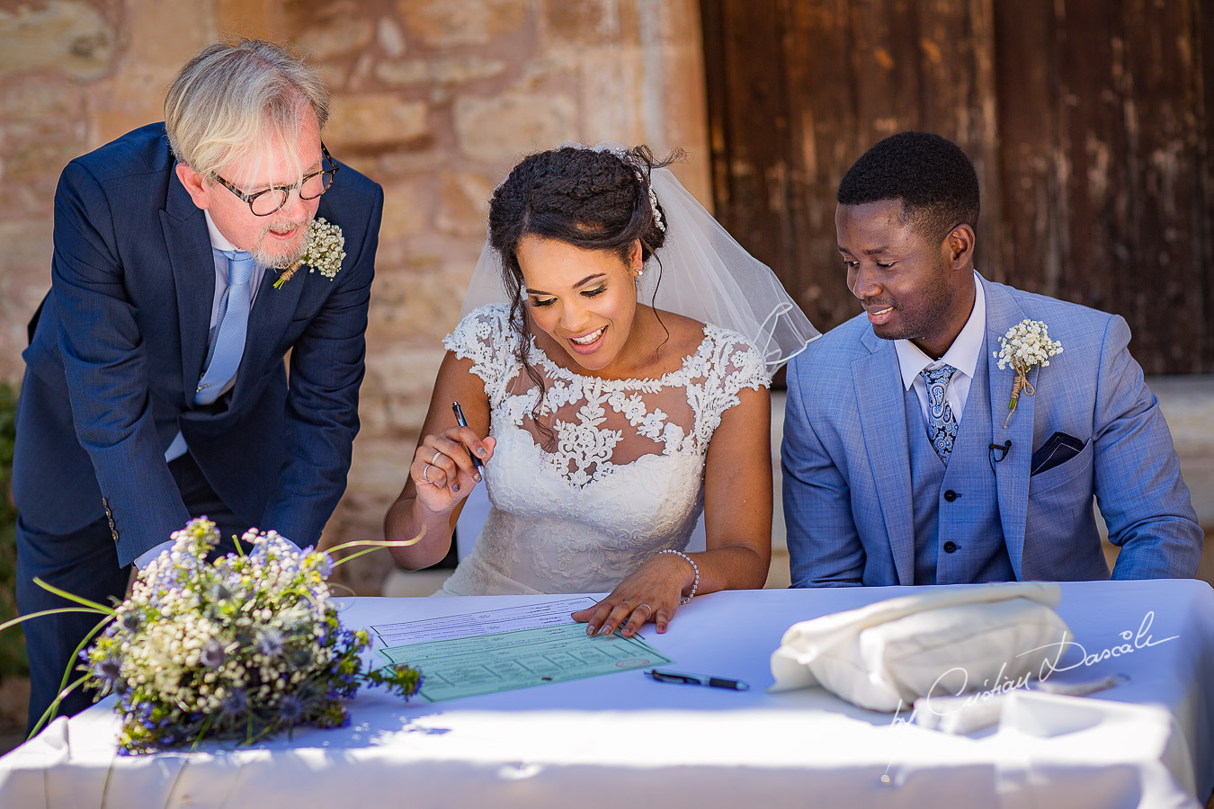 Bride and groom signing their wedding certificates, moments captured at a wedding at Minthis Hills in Cyprus, by Cristian Dascalu.