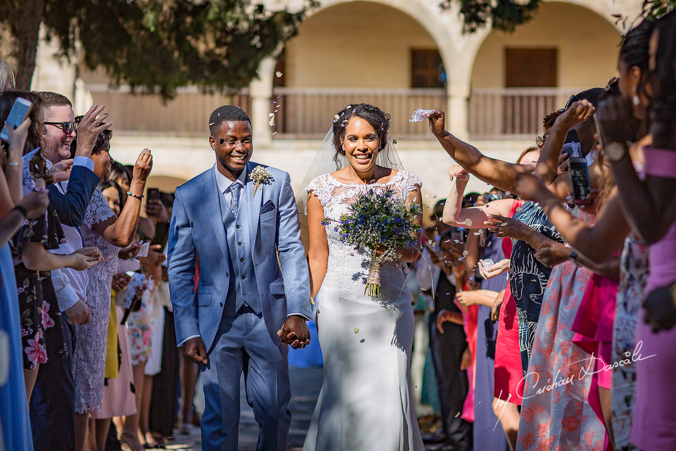 Beautiful confetti photos Beautiful ceremony moments captured at a wedding at Minthis Hills in Cyprus, by Cristian Dascalu.