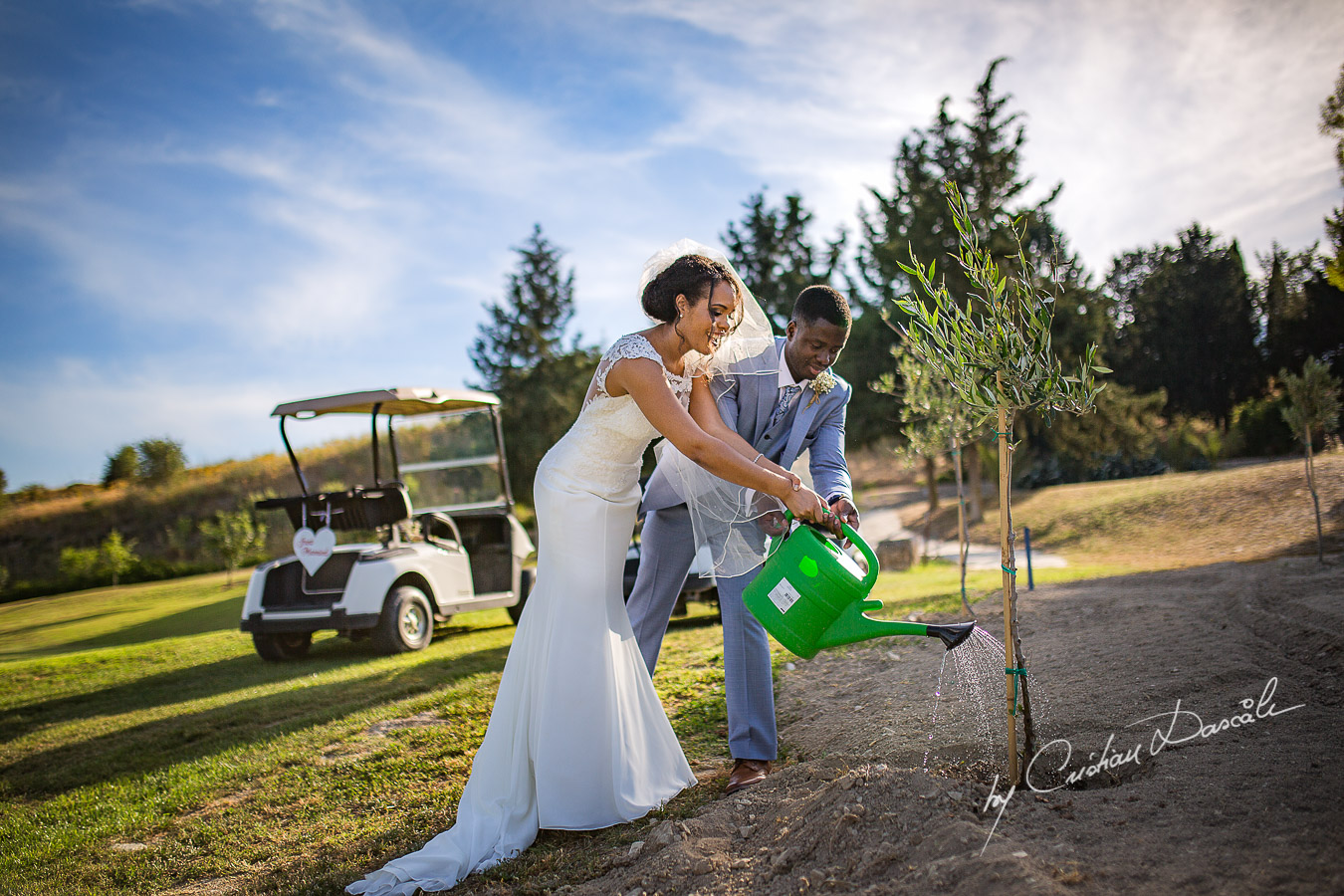 Bride and Groom planting an olive tree, moments captured at a wedding at Minthis Hills in Cyprus, by Cristian Dascalu.