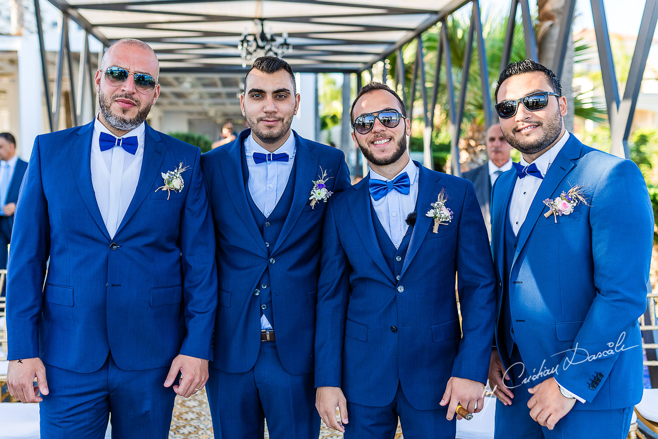 Groom and best men posing before the reception, as part of an Exclusive Wedding photography at Grand Resort Limassol, captured by Cyprus Wedding Photographer Cristian Dascalu.