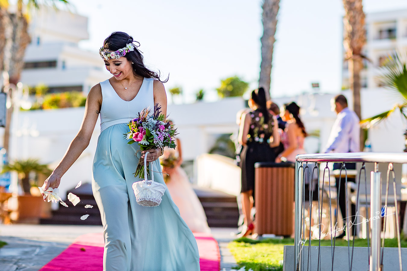 Bridesmaid photographed during the ceremony, as part of an Exclusive Wedding photography at Grand Resort Limassol, captured by Cyprus Wedding Photographer Cristian Dascalu.