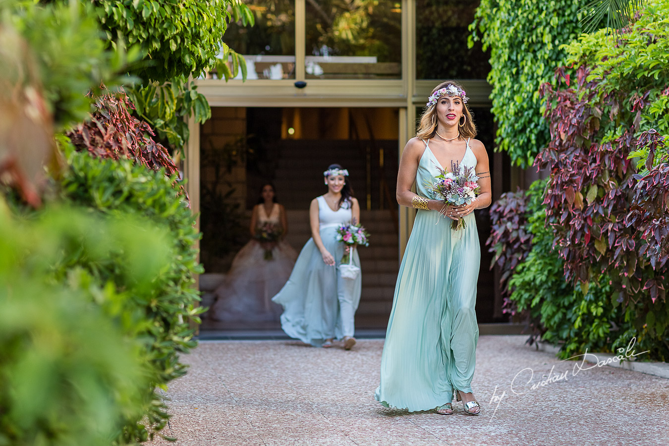 Bridesmaids photographed during the ceremony, as part of an Exclusive Wedding photography at Grand Resort Limassol, captured by Cyprus Wedding Photographer Cristian Dascalu.