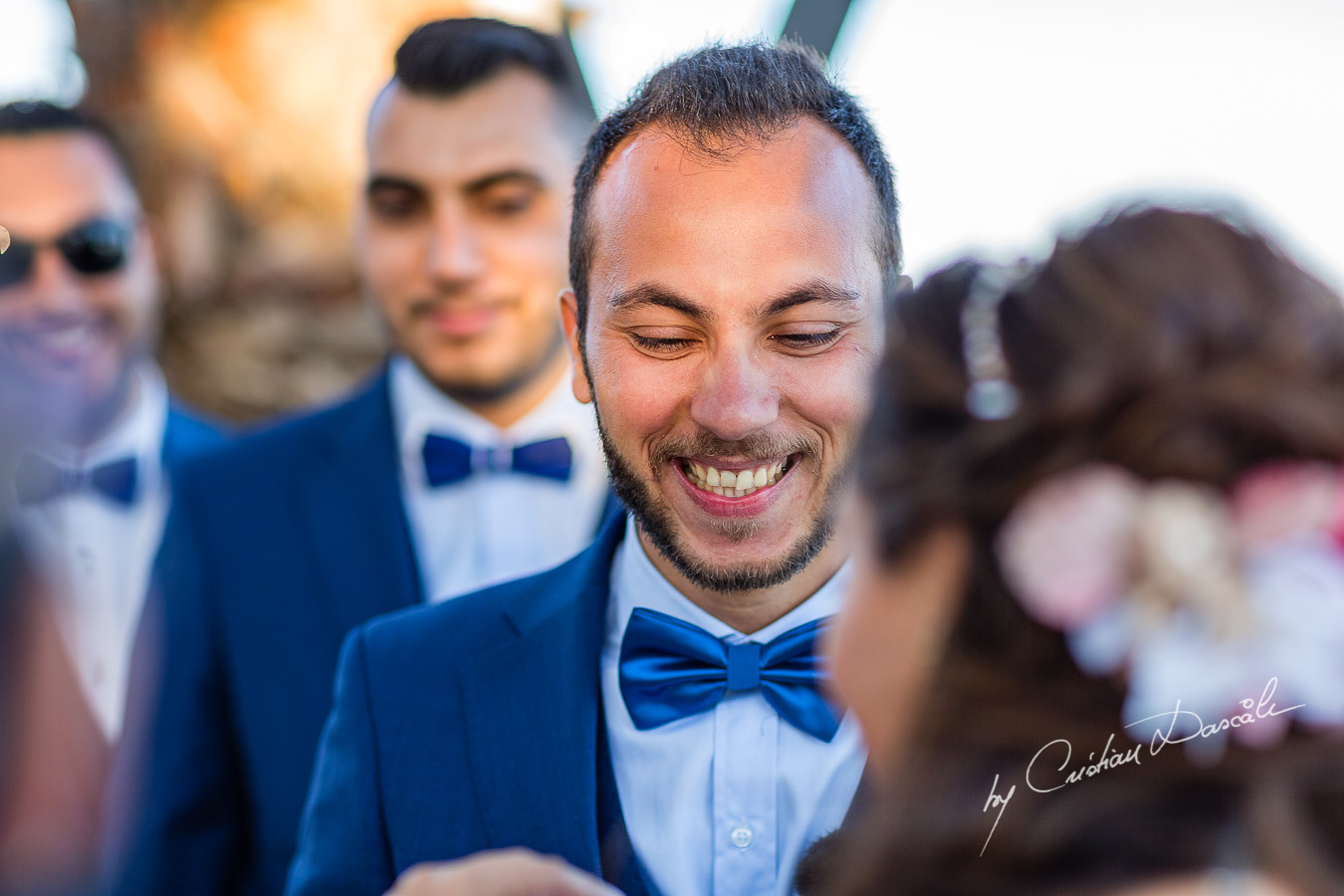 Genuine moments with the groom and the bride during the ceremony, as part of an Exclusive Wedding photography at Grand Resort Limassol, captured by Cyprus Wedding Photographer Cristian Dascalu.