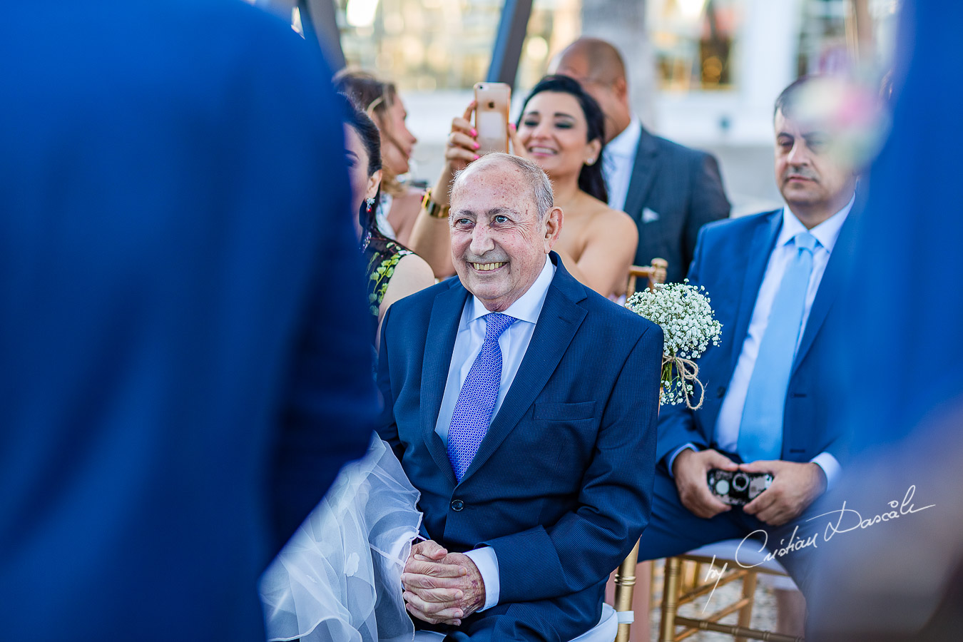 Beautiful moments with the father of the bride during the ceremony, as part of an Exclusive Wedding photography at Grand Resort Limassol, captured by Cyprus Wedding Photographer Cristian Dascalu.