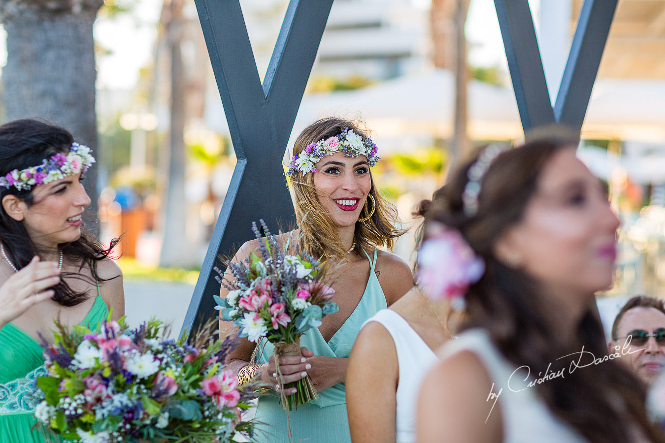Genuine moments with the bridesmaids during the ceremony, as part of an Exclusive Wedding photography at Grand Resort Limassol, captured by Cyprus Wedding Photographer Cristian Dascalu.