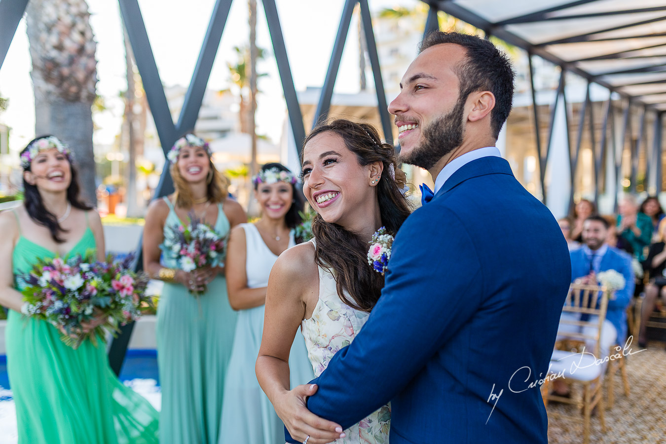 Genuine moments with the bride and groom during the ceremony, as part of an Exclusive Wedding photography at Grand Resort Limassol, captured by Cyprus Wedding Photographer Cristian Dascalu.