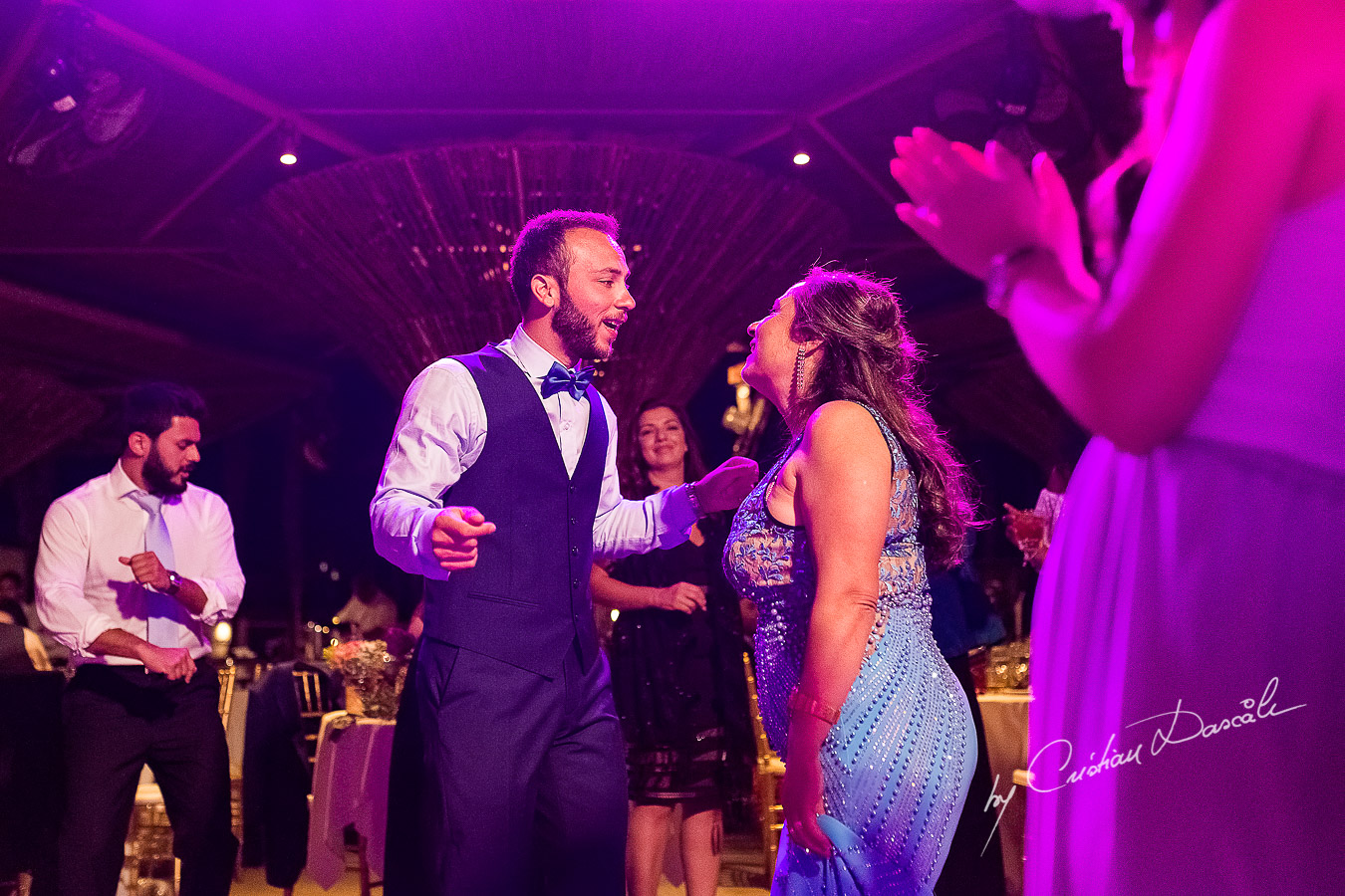Groom dancing with his mother, a unique moment photographed as part of an Exclusive Wedding photography at Grand Resort Limassol, captured by Cyprus Wedding Photographer Cristian Dascalu.
