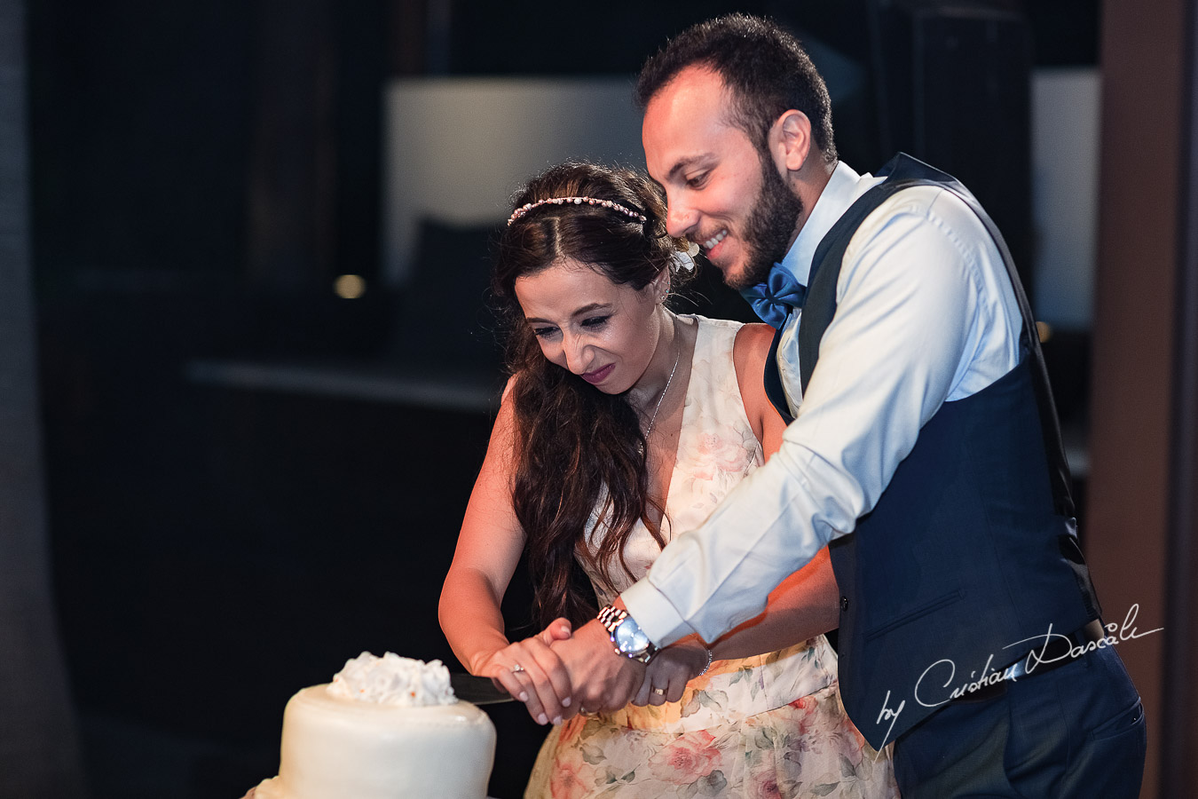 Funny moments when the couple is cutting the cake photographed as part of an Exclusive Wedding photography at Grand Resort Limassol, captured by Cyprus Wedding Photographer Cristian Dascalu.