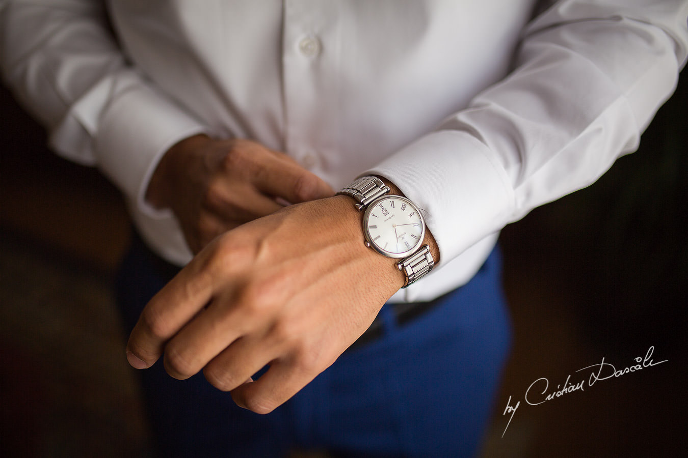 The Groom, Alexis, arranging his Edox watch, captured at a wedding in Cyprus by Photographer Cristian Dascalu.