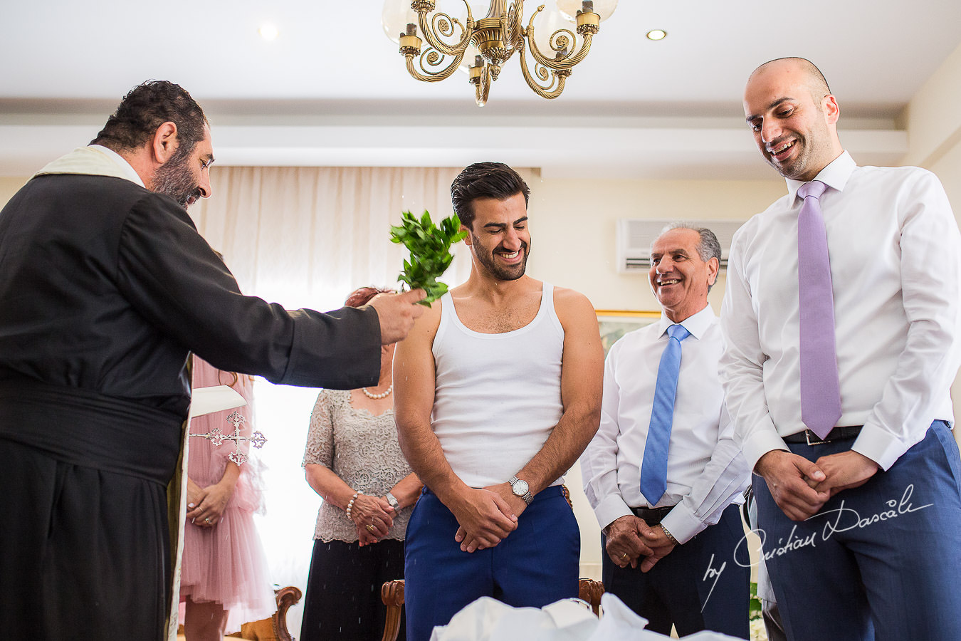 The priest and the groom during a traditional ceremony, captured at a wedding in Cyprus by Photographer Cristian Dascalu.