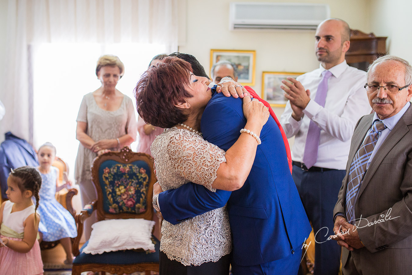 Mom and son moments, captured at a wedding in Cyprus by Photographer Cristian Dascalu.