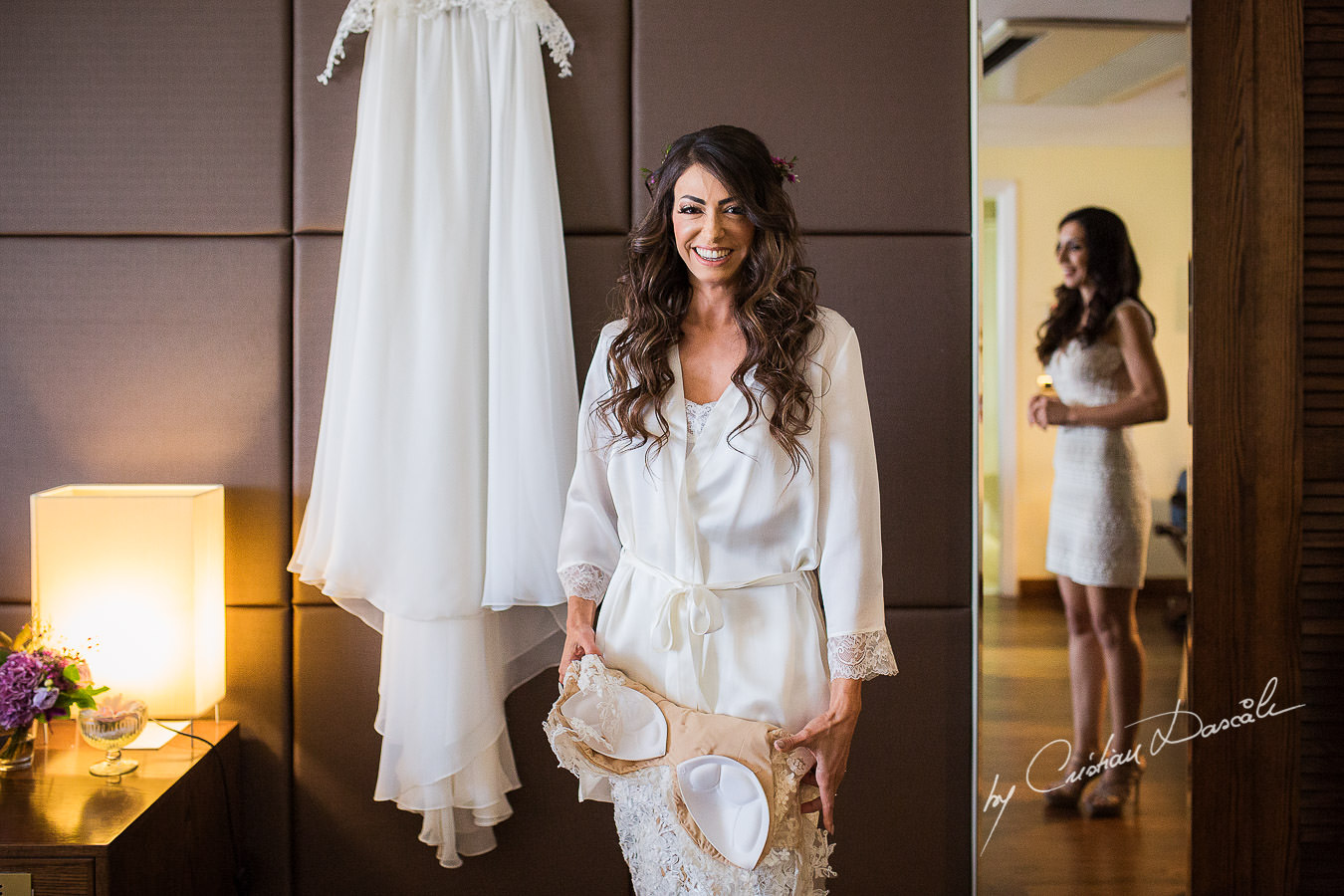Christiana, the bride, smiling while getting ready for her wedding ceremony, moments captured at a wedding in Cyprus by Cristian Dascalu Photographer.