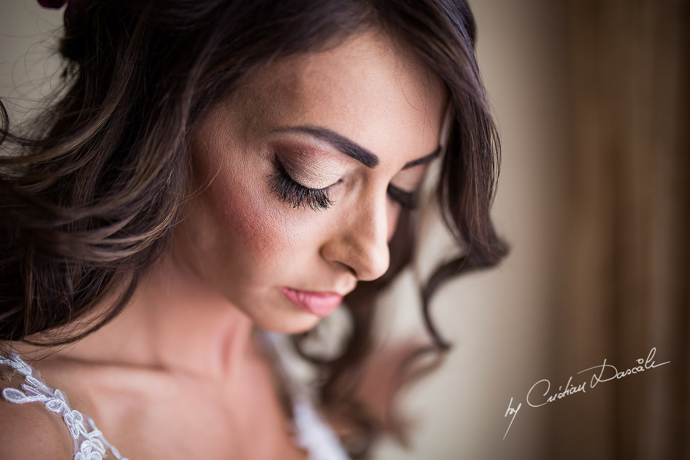 Christiana, the bride, helped by her koumera while getting ready for her wedding ceremony, moments captured at a wedding in Cyprus by Cristian Dascalu Photographer.