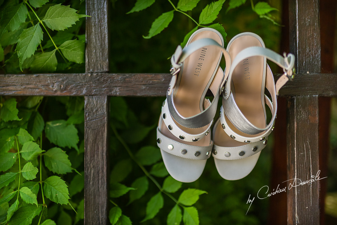 A beautiful wedding day at the Vasilias Nikoklis Inn in Paphos, captured by Cristian Dascalu. Sarah's wedding shoes photographed on Inn's gate.
