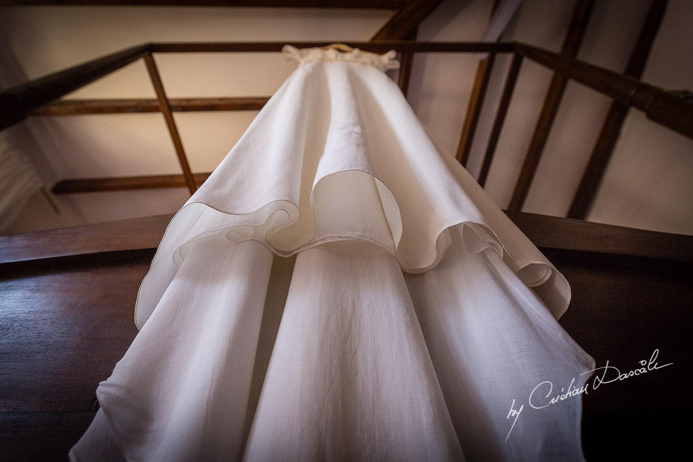 A beautiful wedding day at the Vasilias Nikoklis Inn in Paphos, captured by Cristian Dascalu. The Bride's Dress.