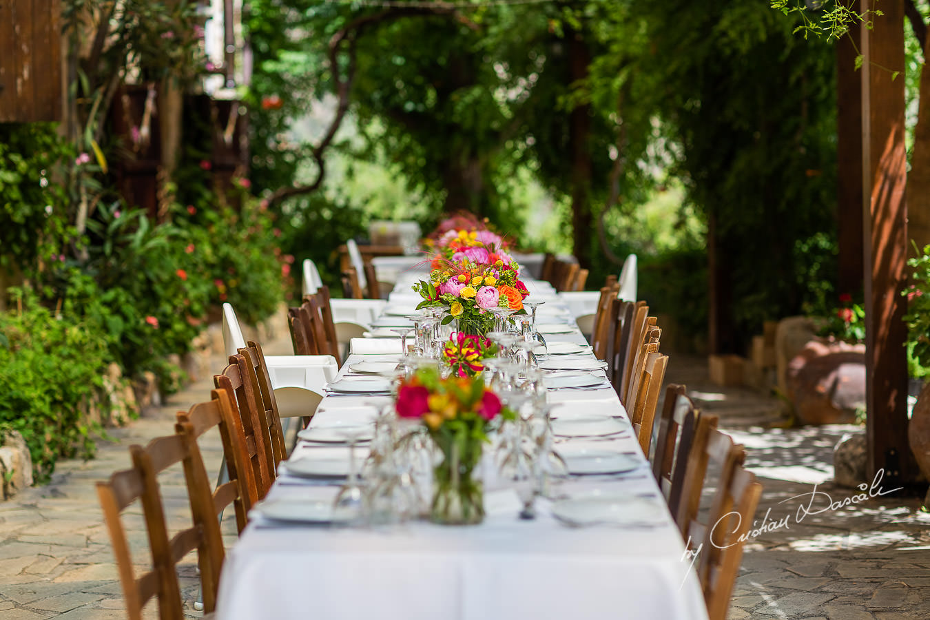A beautiful wedding day at the Vasilias Nikoklis Inn in Paphos, captured by Cristian Dascalu. The dinner table.