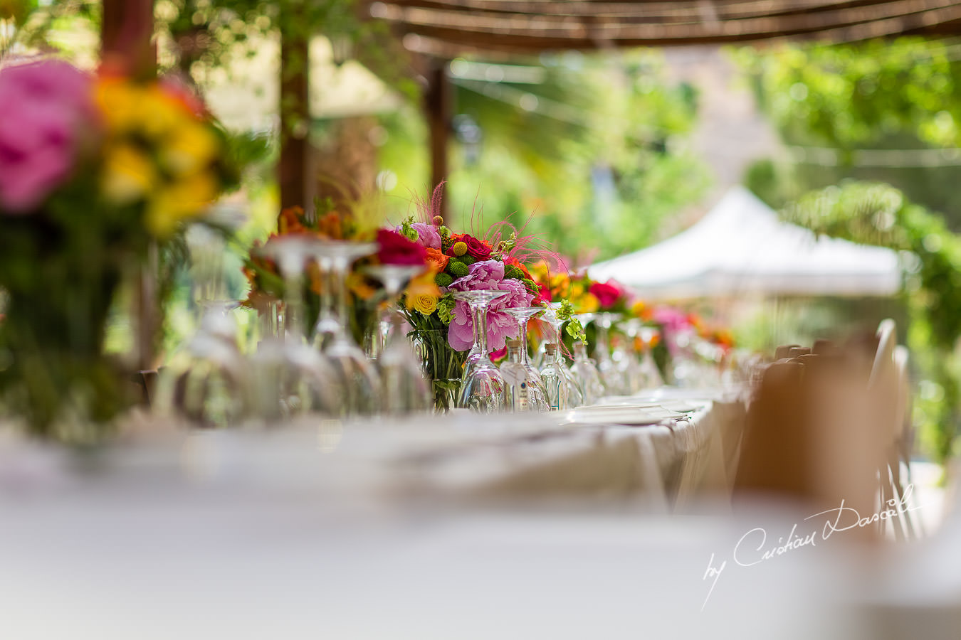 A beautiful wedding day at the Vasilias Nikoklis Inn in Paphos, captured by Cristian Dascalu. The dinner's table.