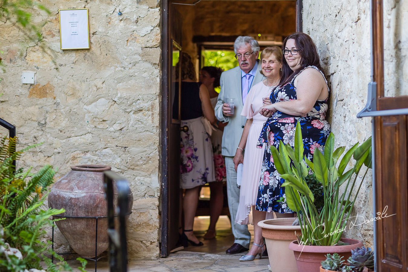 A beautiful wedding day at the Vasilias Nikoklis Inn in Paphos, captured by Cristian Dascalu. Relatives waiting for the wedding ceremony.