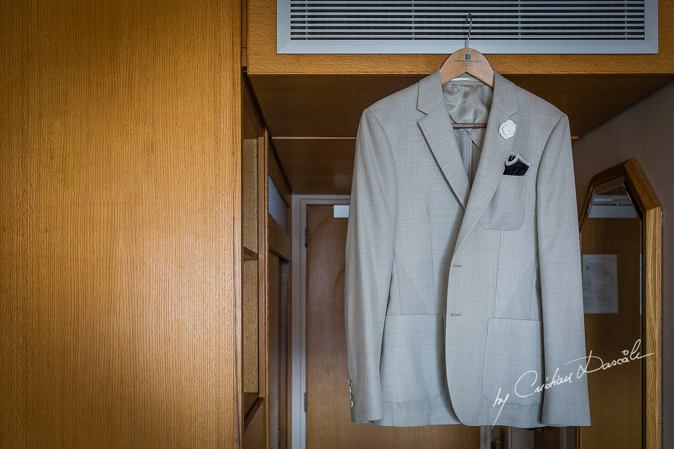 Groom's suit photographed by Cristian Dascalu at Athena Beach Hotel in Paphos, Cyprus, during a symbolic wedding.