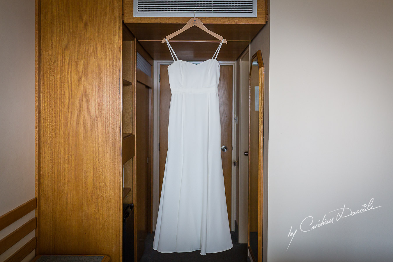 Bride's dress photographed by Cristian Dascalu at Athena Beach Hotel in Paphos, Cyprus, during a symbolic wedding.