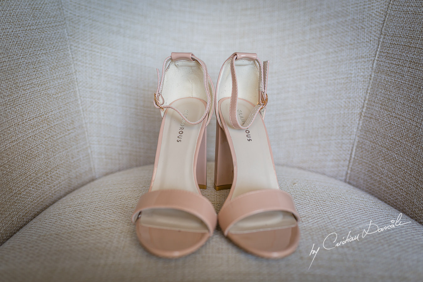 Bride's shoes photographed by Cristian Dascalu at Athena Beach Hotel in Paphos, Cyprus, during a symbolic wedding.