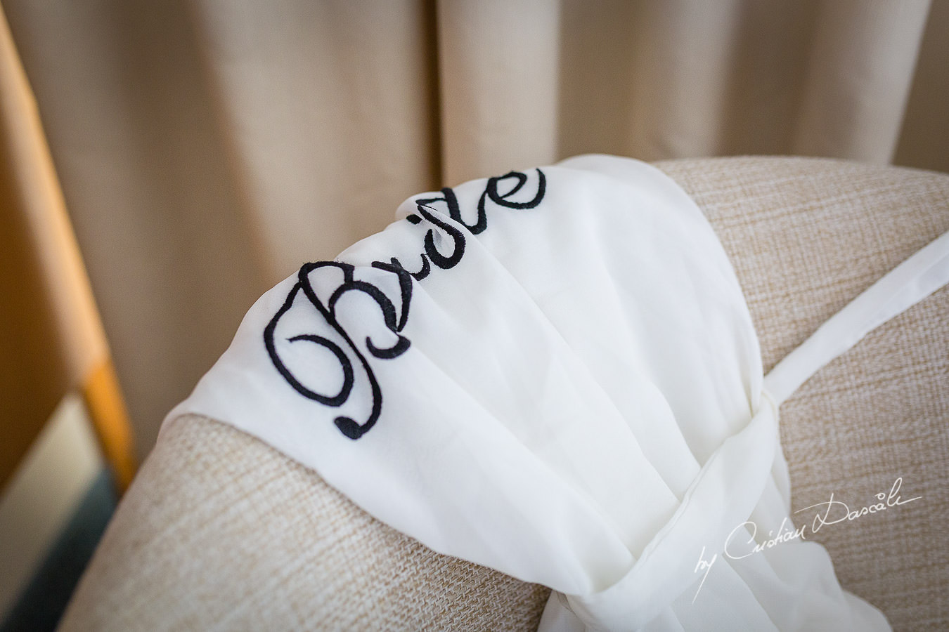 Bride's outfit photographed by Cristian Dascalu at Athena Beach Hotel in Paphos, Cyprus, during a symbolic wedding.
