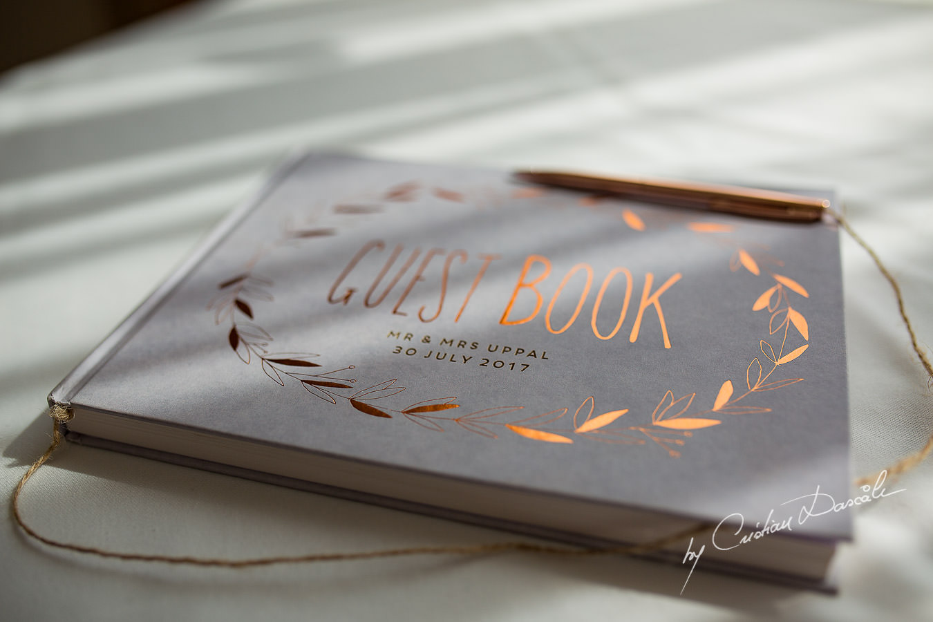 The guest book photographed by Cristian Dascalu at Athena Beach Hotel in Paphos, Cyprus, during a symbolic wedding.