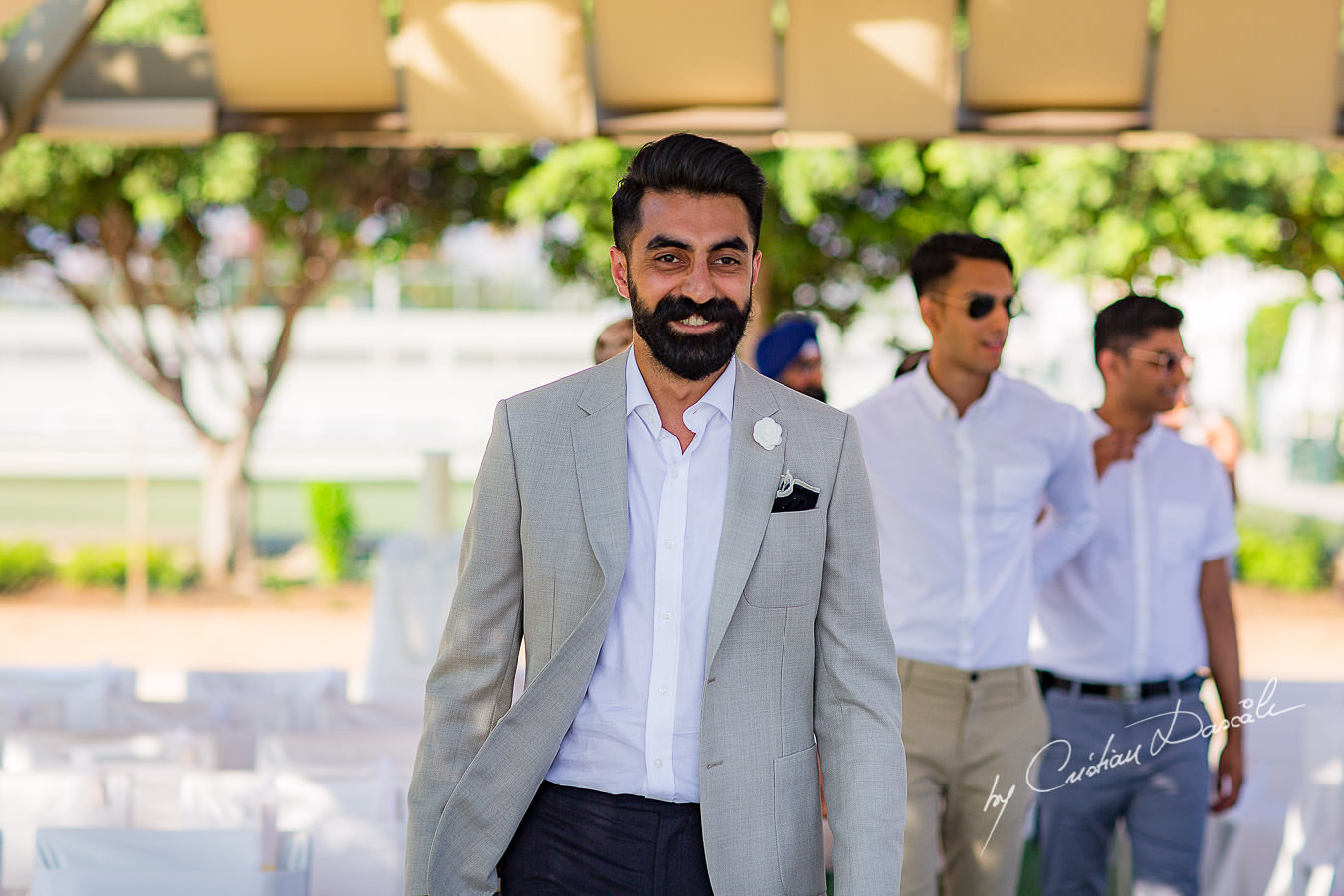 The groom arriving for the wedding ceremony, moments photographed by Cristian Dascalu at Athena Beach Hotel in Paphos, Cyprus, during a symbolic wedding.