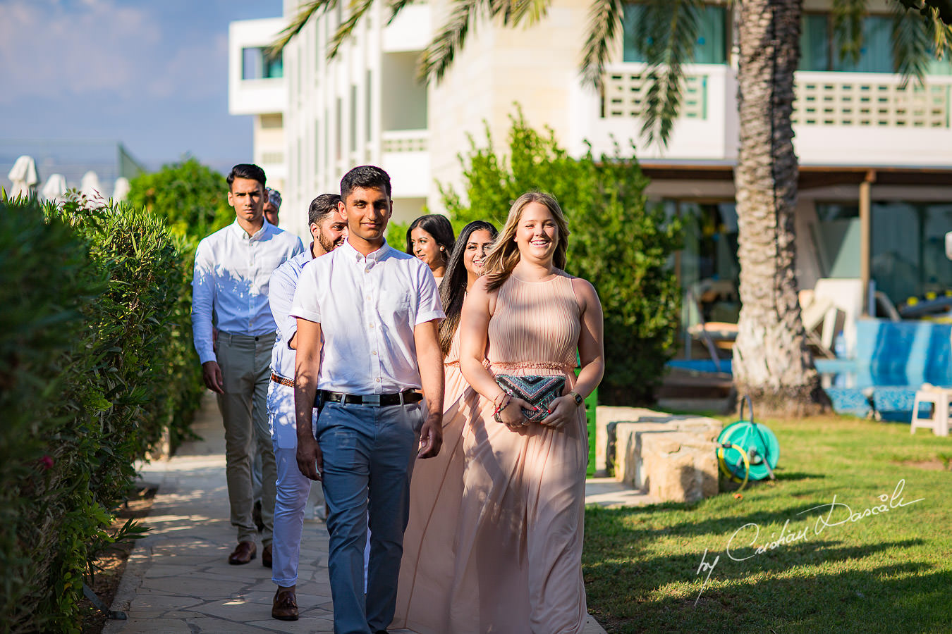 Groomsmen and bridesmaids arriving for the wedding ceremony, moments photographed by Cristian Dascalu at Athena Beach Hotel in Paphos, Cyprus, during a symbolic wedding.