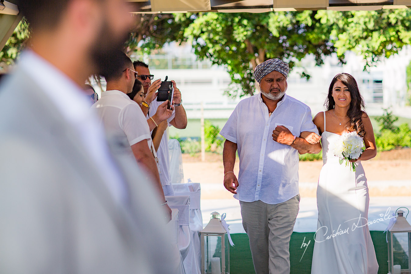 Bride's arrival, moments photographed by Cristian Dascalu at Athena Beach Hotel in Paphos, Cyprus, during a symbolic wedding.