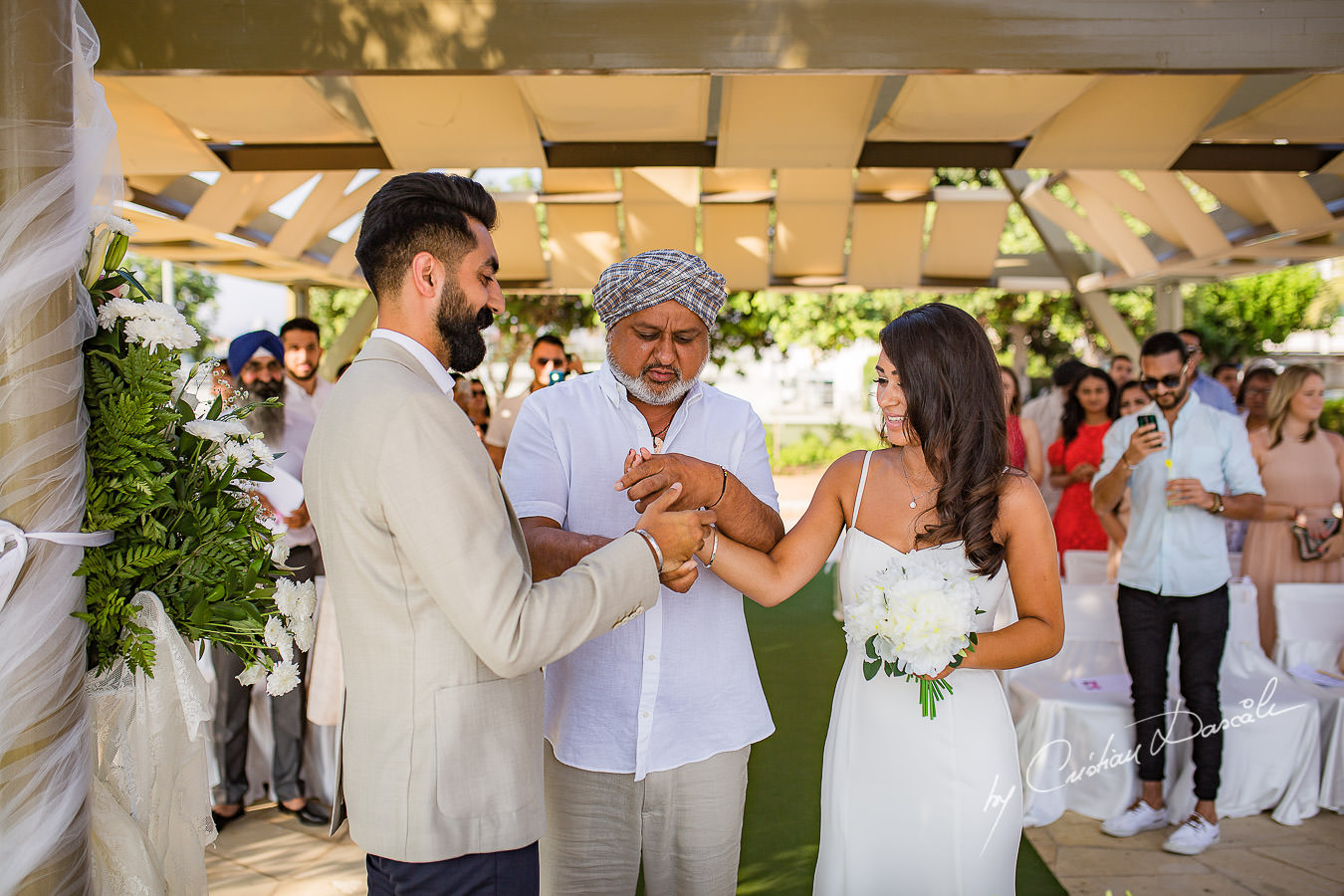 The father of the bride giving his blessings before the wedding ceremony, moments photographed by Cristian Dascalu at Athena Beach Hotel in Paphos, Cyprus, during a symbolic wedding.
