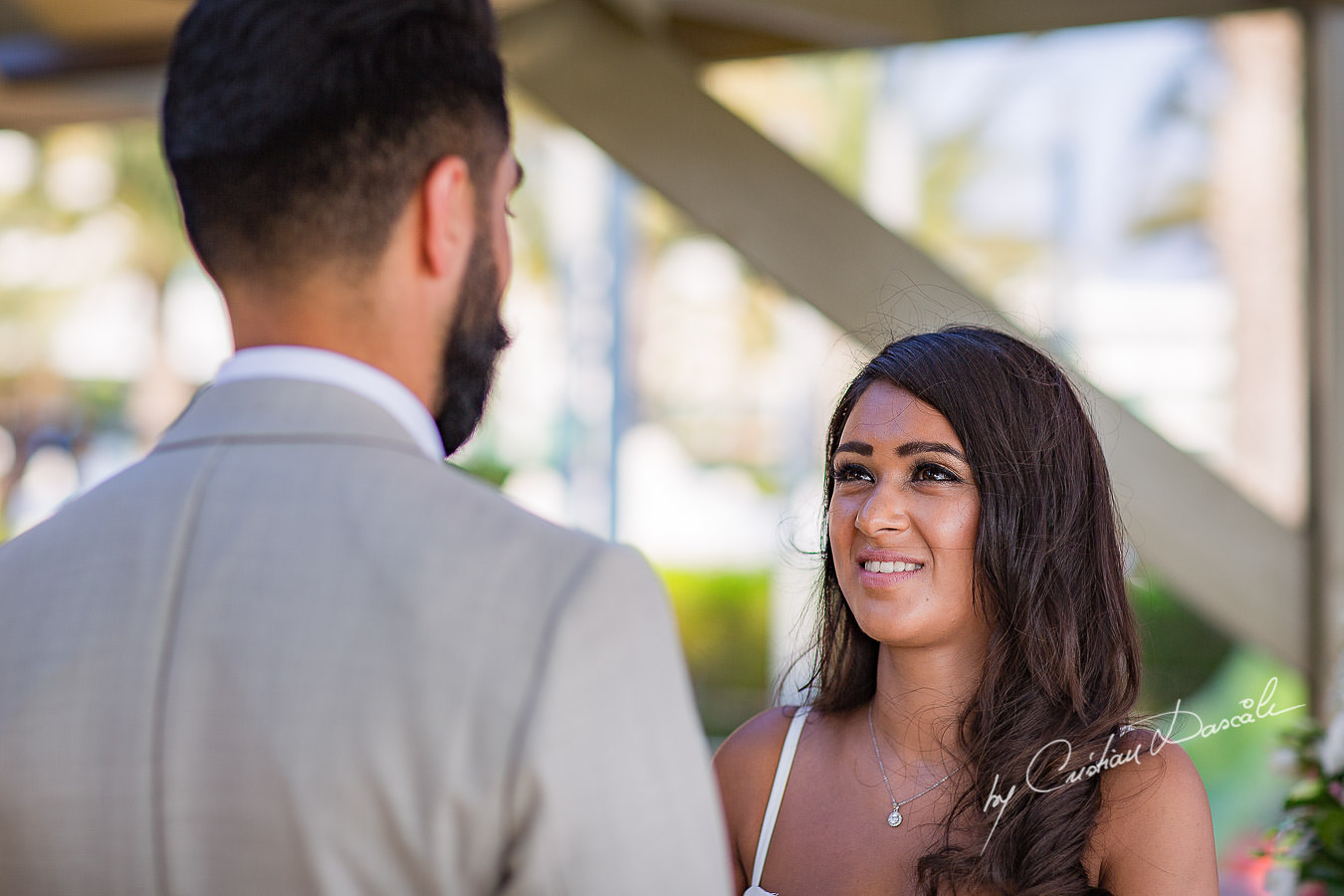 Bride and Groom changing vows, moments photographed by Cristian Dascalu at Athena Beach Hotel in Paphos, Cyprus, during a symbolic wedding.