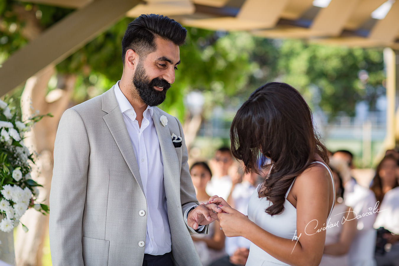 Bride and Groom changing rings, moments photographed by Cristian Dascalu at Athena Beach Hotel in Paphos, Cyprus, during a symbolic wedding.