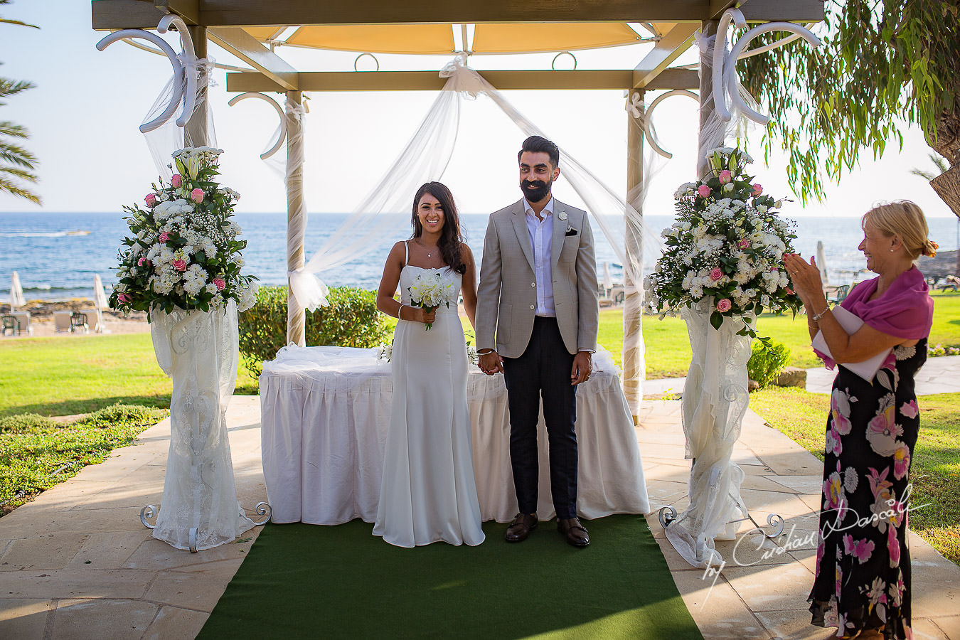 Moments photographed by Cristian Dascalu at Athena Beach Hotel in Paphos, Cyprus, during a symbolic wedding.