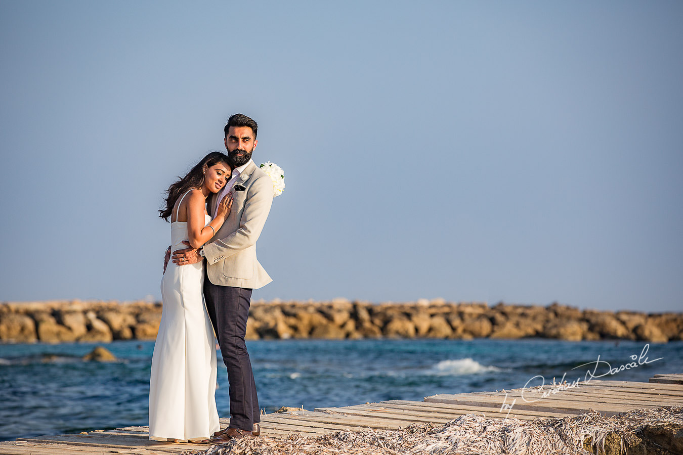 Harpreet and Sabrina photographed by Cristian Dascalu at Athena Beach Hotel in Paphos, Cyprus, during a symbolic wedding.