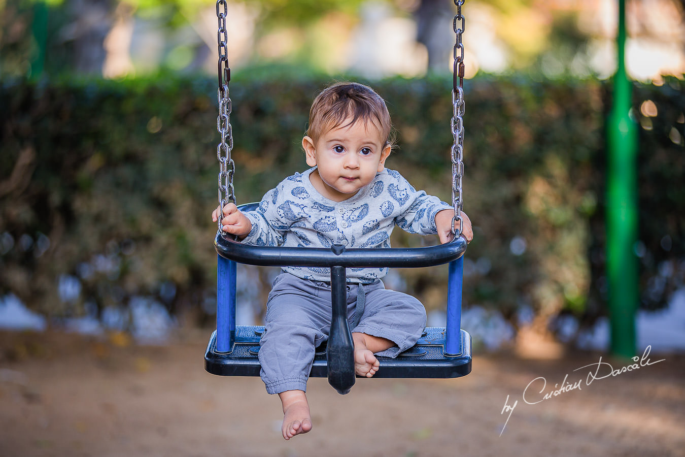 Smallest family member in swing, moments captured by Cristian Dascalu during a beautiful Limassol family photography photo session.