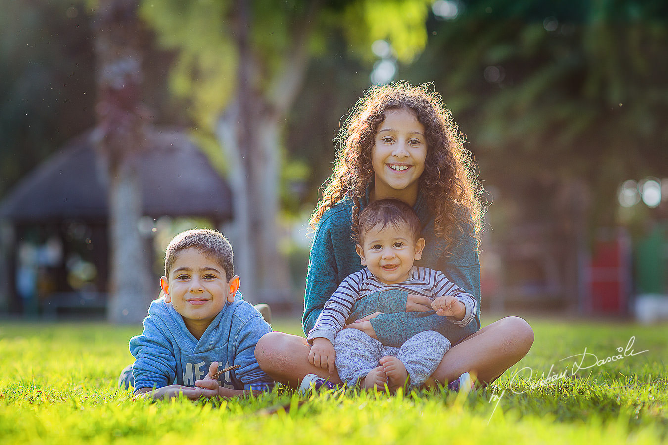 Brothers and sister in the park, moments captured by Cristian Dascalu during a beautiful Limassol family photography photo session.
