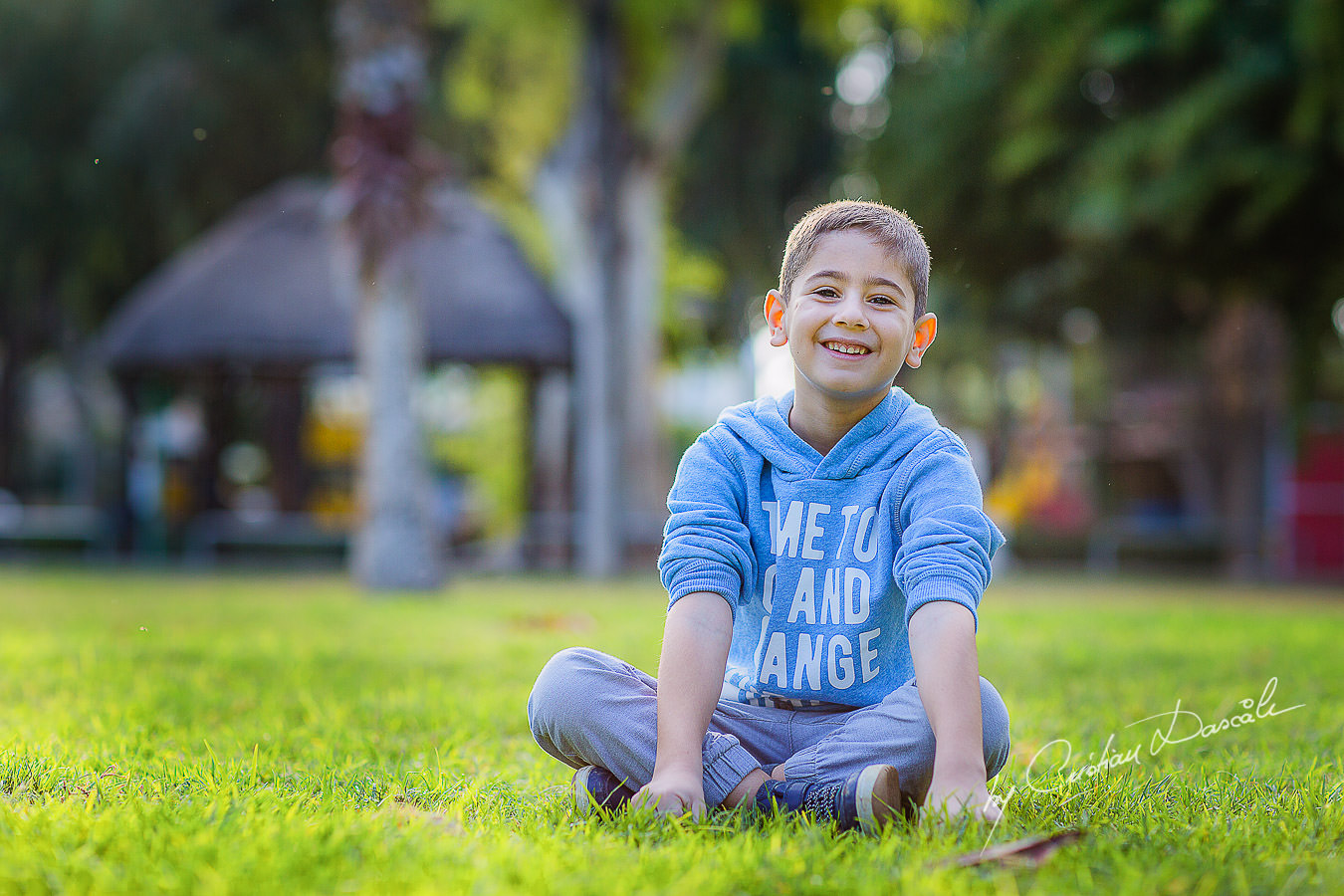 Handsome young boy in the park, moments captured by Cristian Dascalu during a beautiful Limassol family photography photo session.