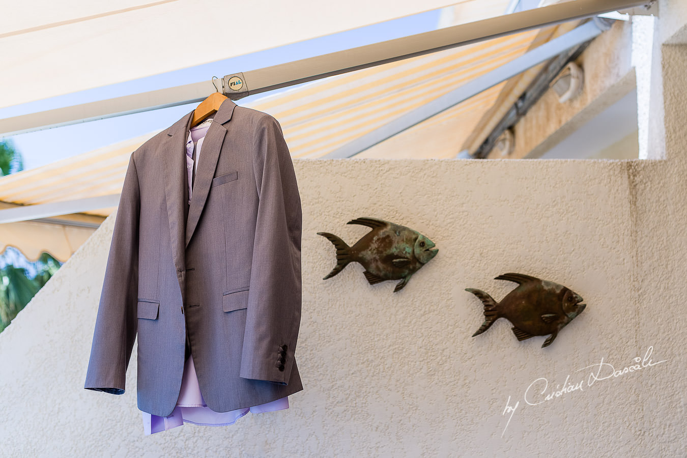 Groom's suit hanged at the groom's house during a wedding at St Raphael Limassol.