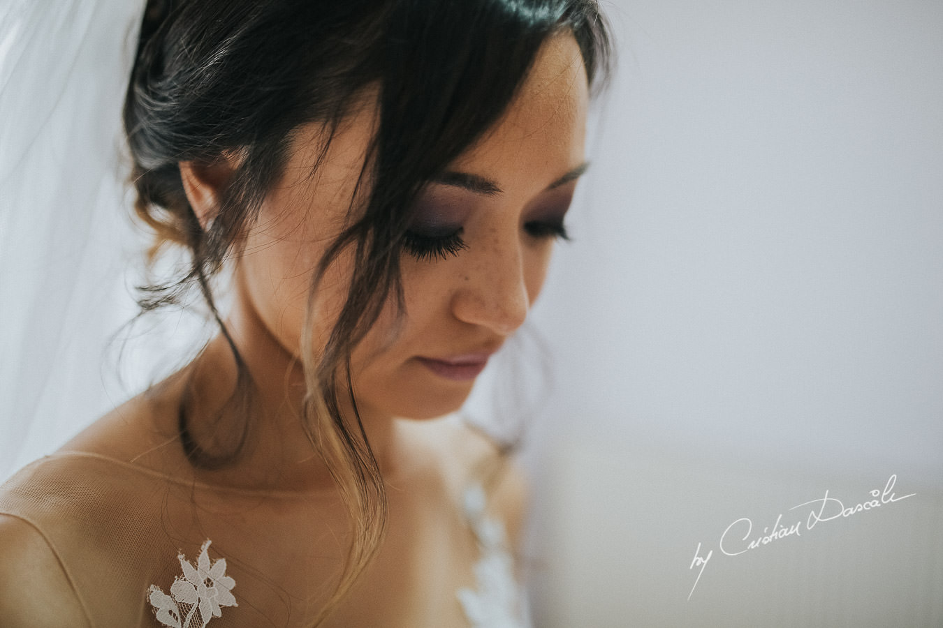 The bride Christina, getting ready for her traditional Cypriot ceremony, moments captured during a wedding at St Raphael Resort in Limassol, Cyprus.