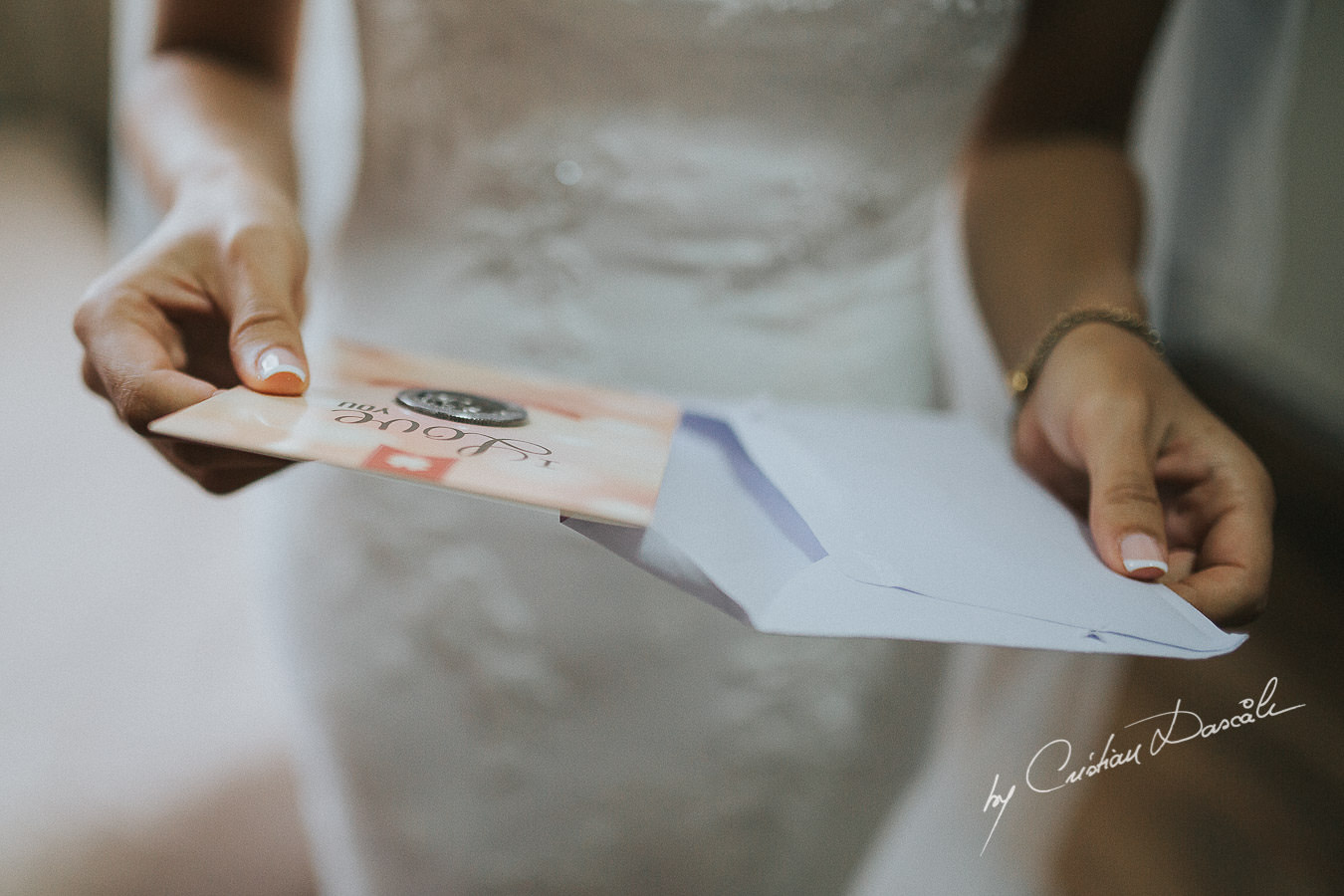 The bride Christina, opening a gift form her future husband to be, moments captured during a wedding at St Raphael Resort in Limassol, Cyprus.