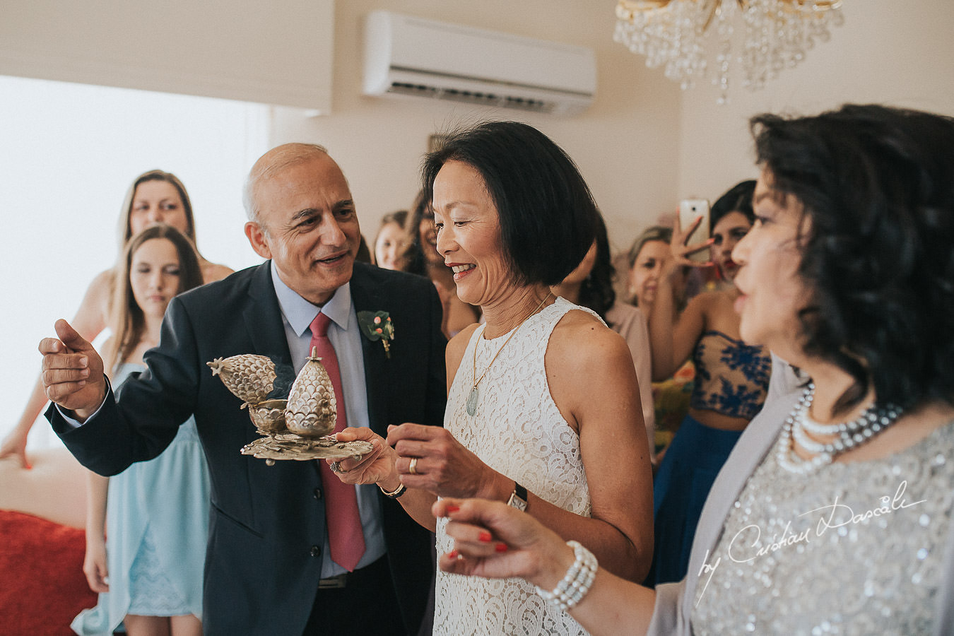 Guest gives her blessing at a traditional wedding ceremony in Limassol, Cyprus.