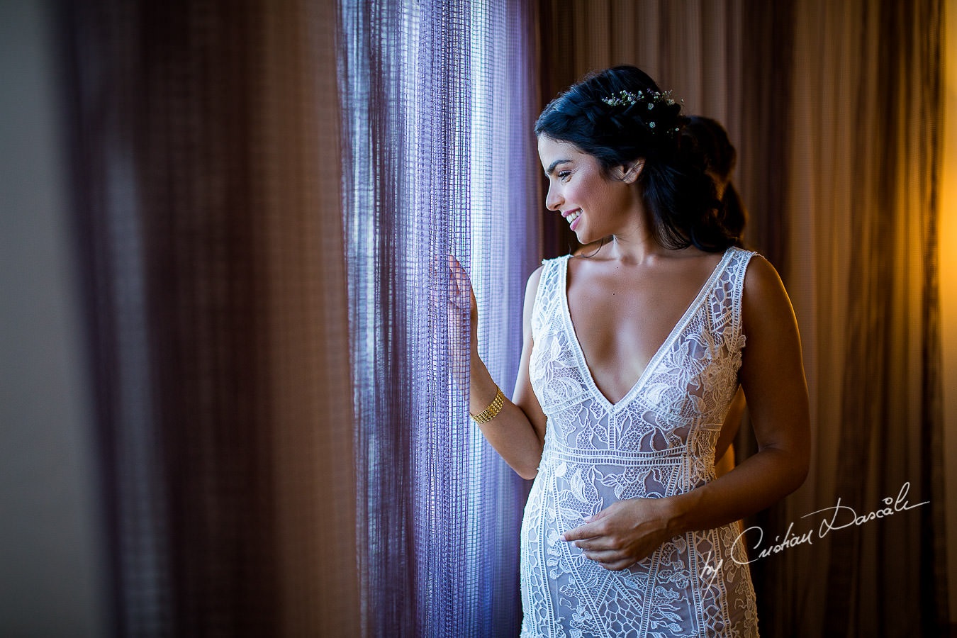 Smiling bridal portrait captured during a wedding photography at the Lighthouse Limassol, by Cyprus Photographer Cristian Dascalu.