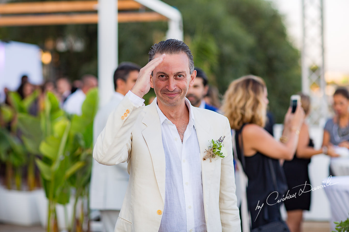 The best man saluting, moments captured during a wedding photography at the Lighthouse Limassol, by Cyprus Photographer Cristian Dascalu.
