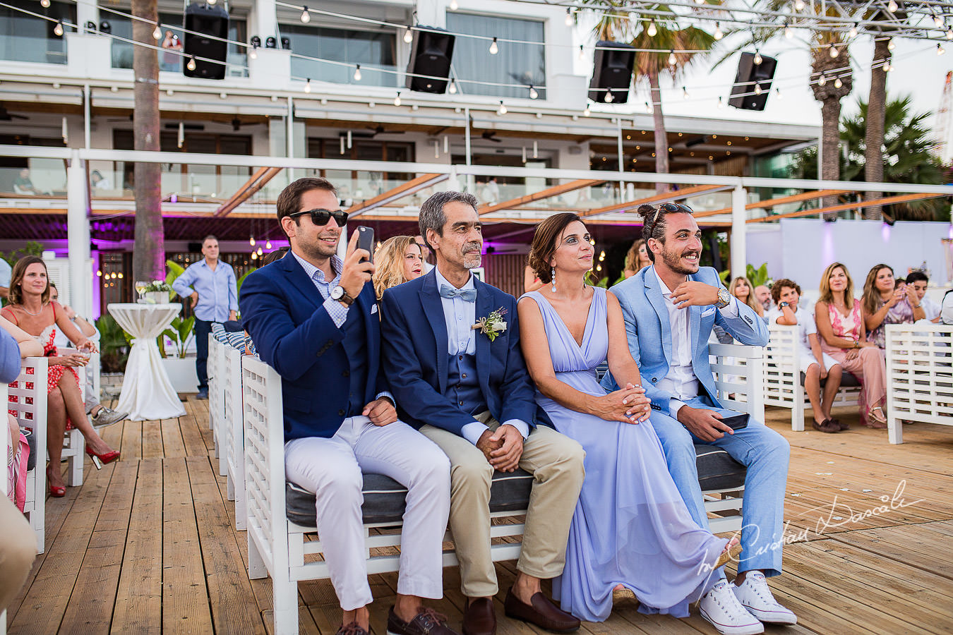 Wedding guests moments captured during a wedding photography at the Lighthouse Limassol, by Cyprus Photographer Cristian Dascalu.