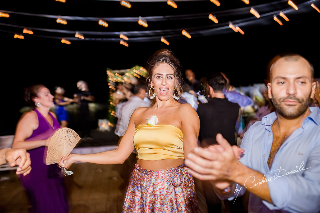Guests dancing moments captured during a wedding photography at the Lighthouse Limassol, by Cyprus Photographer Cristian Dascalu.