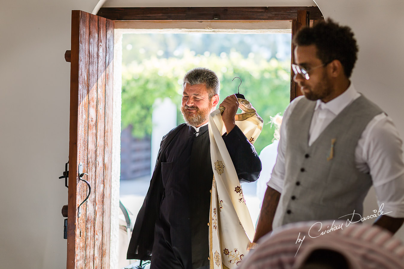 The priest arriving for a Christening the beautiful Anassa Hotel photographed by Cyprus Photographer Cristian Dascalu.
